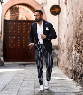How to wear: navy blazer, white dress shirt, navy vertical striped chinos, white leather low top sneakers