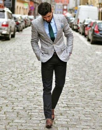 How to Wear Brown Leather Tassel Loafers: A grey plaid blazer and black chinos are an easy way to inject a sense of manly sophistication into your casual lineup. Introduce a pair of brown leather tassel loafers to this ensemble for an instant style fix.