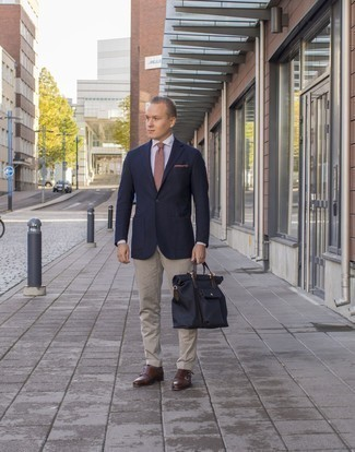 How to Wear Beige Chinos: A navy blazer and beige chinos are essential in any modern man's great wardrobe. Add brown leather double monks to the mix to spice things up.