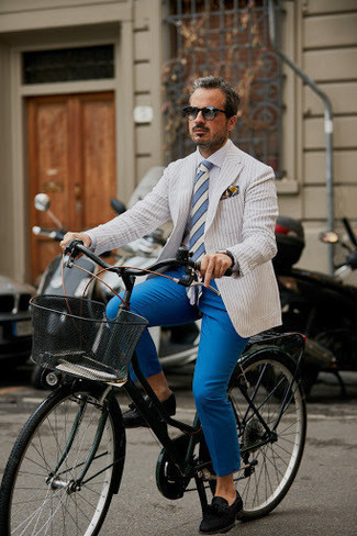 How to Wear a White Vertical Striped Blazer For Men: Team a white vertical striped blazer with blue chinos to be the picture of masculine elegance. A pair of black suede tassel loafers immediately kicks up the fashion factor of any getup.