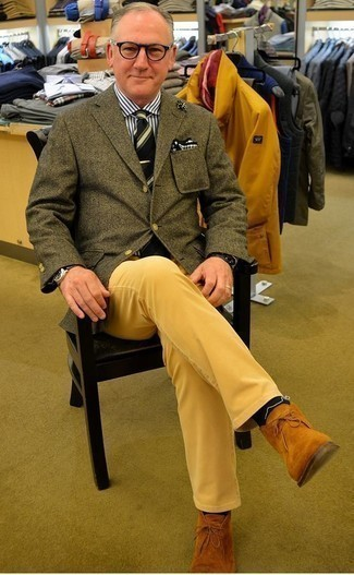 How to Wear Yellow Chinos: An olive herringbone blazer and yellow chinos are among those versatile items that have become the absolute essentials in any gent's collection. Tobacco suede desert boots will be a stylish complement for this ensemble.