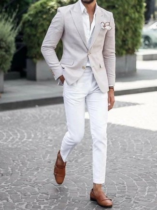 How to Wear a Beige Blazer For Men: A beige blazer and white chinos are absolute staples if you're crafting a classic and casual closet that matches up to the highest menswear standards. You can get a little creative in the shoe department and complete your outfit with brown leather double monks.