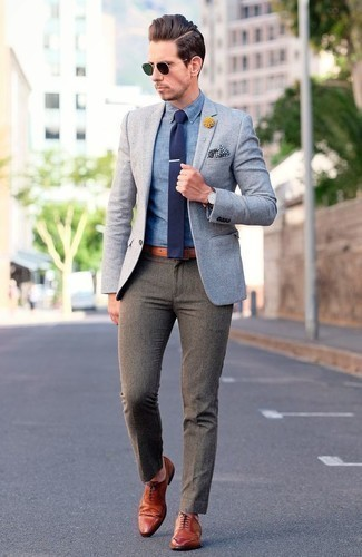 How to Wear a Light Blue Blazer For Men: This semi-casual combination of a light blue blazer and grey chinos is extremely easy to pull together without a second thought, helping you look amazing and ready for anything without spending too much time going through your wardrobe. Complement this look with tobacco leather brogues to completely shake up the outfit.