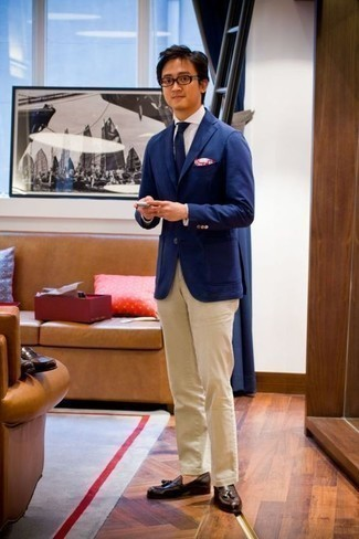 How to Wear Dark Brown Leather Tassel Loafers: This combination of a blue blazer and beige chinos might pack a punch, but it's extremely easy to achieve. Let your styling sensibilities really shine by rounding off this ensemble with a pair of dark brown leather tassel loafers.