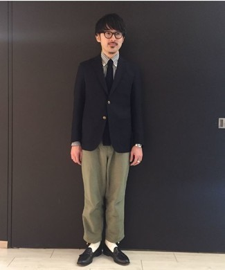 How to Wear Olive Chinos: You'll be amazed at how easy it is for any man to pull together this casually neat ensemble. Just a black blazer and olive chinos. Complete this ensemble with a pair of black leather tassel loafers to serve a little mix-and-match magic.