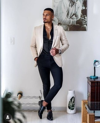 How to Wear a Black Dress Shirt For Men: This combination of a black dress shirt and navy chinos is an interesting balance between formal and laid-back. And if you want to immediately spruce up this outfit with a pair of shoes, introduce a pair of black leather derby shoes to the equation.