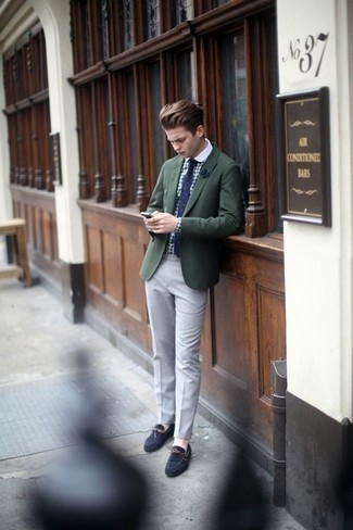 How to Wear a Dark Green Blazer For Men: Such staples as a dark green blazer and grey chinos are an easy way to introduce a dose of rugged refinement into your casual styling rotation. Add navy suede driving shoes to the equation to inject a sense of stylish nonchalance into your outfit.