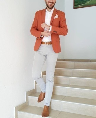 How to Wear Grey Chinos: For an outfit that's city-style-worthy and casually smart, consider wearing an orange blazer and grey chinos. And if you want to easily smarten up your ensemble with one single item, why not complement this look with tan leather derby shoes?