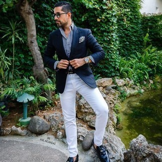 How to Wear Black Leather Tassel Loafers: Dress in a navy blazer and white chinos to create an effortlessly classic and put together ensemble. To give your overall ensemble a smarter twist, why not add a pair of black leather tassel loafers to the mix?