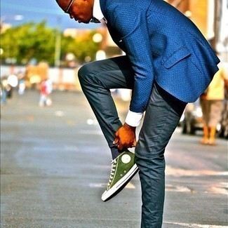 Bow-tie Outfits For Men: Rock a blue print blazer with a bow-tie for equally dapper and easy-to-wear look. Let your outfit coordination credentials really shine by rounding off this ensemble with green canvas high top sneakers.