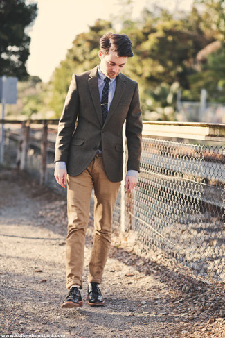 500+ Spring Outfits For Men: A brown wool blazer and khaki chinos will add classic style to your current collection. Black leather derby shoes are an effortless way to add a confident kick to the ensemble. If you're after a stylish winter-to-spring transition outfit, this one fits the bill.