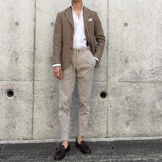 Beige Chinos Outfits: This pairing of a brown houndstooth blazer and beige chinos is proof that a safe look can still be really interesting. Add dark brown leather tassel loafers to the equation for an added touch of polish.