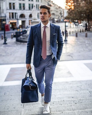 Pink Tie Outfits For Men: When it comes to timeless smart style, this combo of a navy plaid blazer and a pink tie never disappoints. Send an otherwise sober getup in a more casual direction by finishing off with a pair of white canvas low top sneakers.