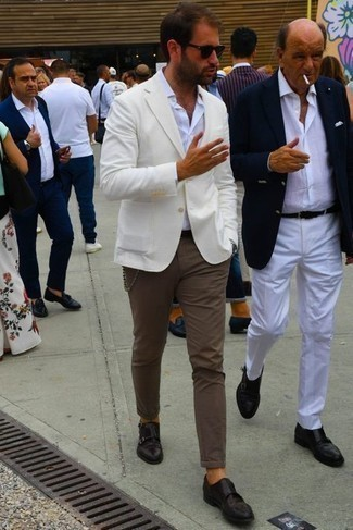 Brown Chinos Outfits: Make a white blazer and brown chinos your outfit choice if you're going for a proper, on-trend ensemble. As for the shoes, you can follow a classier route with dark brown leather double monks.