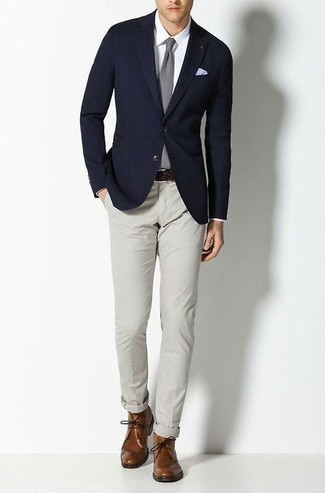 Navy Blazer Outfits For Men: As you can see, looking dapper doesn't take that much time. Choose a navy blazer and grey chinos and you'll look awesome. Add a pair of brown leather desert boots to this ensemble and the whole outfit will come together really well.