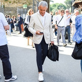 Beige Blazer Outfits For Men After 50: A classic and casual pairing of a beige blazer and navy chinos can be relevant in many different circumstances. You can get a little creative when it comes to footwear and complement this look with a pair of white canvas low top sneakers. Wearing this, any 50-something gent will put any younger dude to shame.