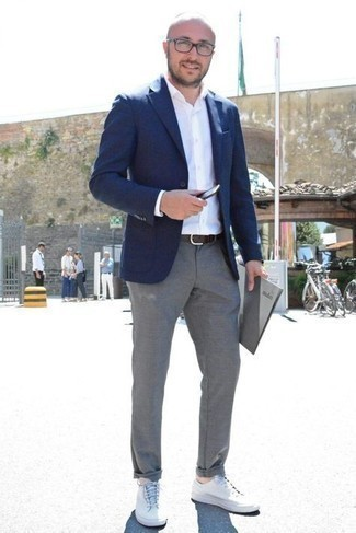 Grey Chinos Outfits: Wear a navy blazer with grey chinos if you're going for a proper, on-trend ensemble. And if you need to effortlessly play down this look with shoes, why not add white canvas low top sneakers to this getup?
