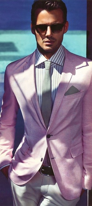 This pairing of a pale pink blazer and beige chinos will set you apart effortlessly.