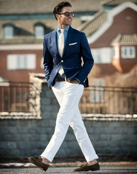 A dark blue sport coat and white chinos are a great outfit formula to have  in