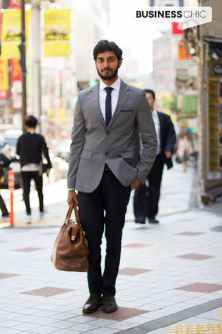 How To Wear a Grey Blazer With Black Dress Pants For Men: This sophisticated pairing of a grey blazer and black dress pants is truly a statement-maker. Introduce dark brown leather derby shoes to your outfit to tie the whole thing together.