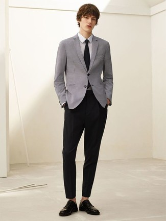 How To Wear a Grey Blazer With Black Dress Pants For Men: This combination of a grey blazer and black dress pants is the picture of elegance. Black leather derby shoes work wonderfully well within this getup.