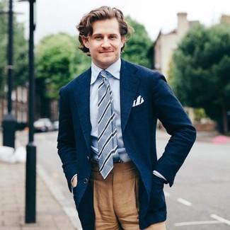 Wear a deep blue sport coat with camel dress pants like a true gent.