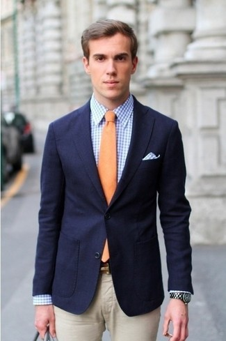 How to wear: navy blazer, blue gingham dress shirt, beige dress pants, orange tie