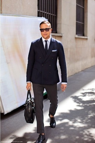 A navy blazer and charcoal dress pants are a seriously dapper outfit to try. Complement your outfit with a pair of black leather oxford shoes and the whole outfit will come together quite nicely.