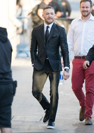 Conor McGregor wearing Black Sequin Blazer, White Dress Shirt, Black Dress Pants, Black Leather Low Top Sneakers