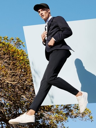 Black Knit Blazer Outfits For Men: Irrefutable proof that a black knit blazer and black dress pants are amazing when paired together in a refined getup for today's guy. You can get a little creative in the footwear department and introduce a pair of white leather low top sneakers to the mix.