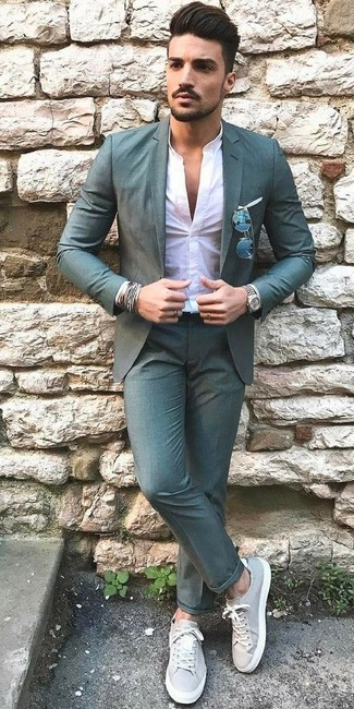 How to Wear Teal Dress Pants For Men: A teal blazer and teal dress pants are among the crucial items of a smart man's wardrobe. And if you need to immediately play down your look with footwear, why not add grey leather low top sneakers to the mix?