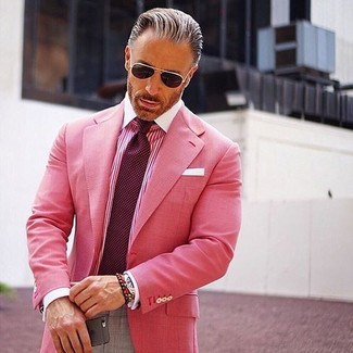 How to wear: hot pink blazer, hot pink vertical striped dress shirt, grey dress pants, burgundy polka dot tie