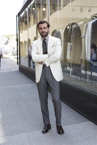 How to wear: white blazer, white and black vertical striped dress shirt, grey dress pants, dark brown leather tassel loafers
