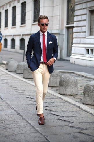 Look the best you possibly can in a navy sportcoat and beige suit pants. Want to go easy on the shoe front? Make dark brown leather loafers your footwear choice for the day.