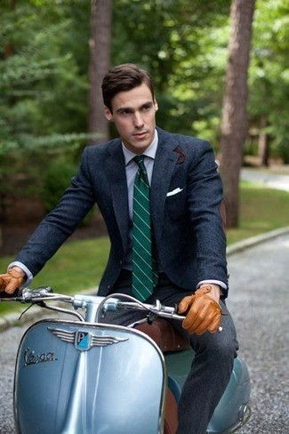 How to wear: navy wool blazer, light blue dress shirt, charcoal wool dress pants, dark green vertical striped tie