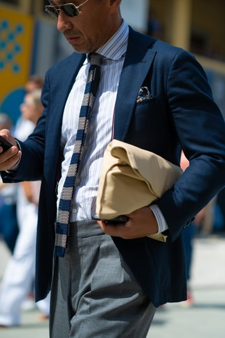 How to wear: navy blazer, white vertical striped dress shirt, grey dress pants, tan leather zip pouch