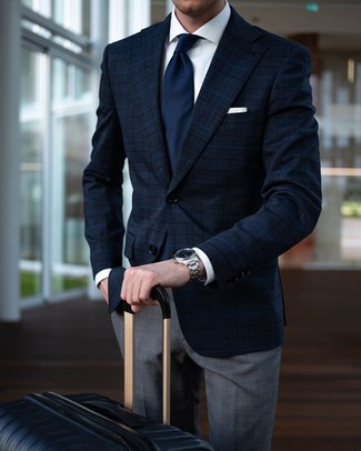 How to wear: navy plaid blazer, white dress shirt, grey plaid dress pants, black suitcase