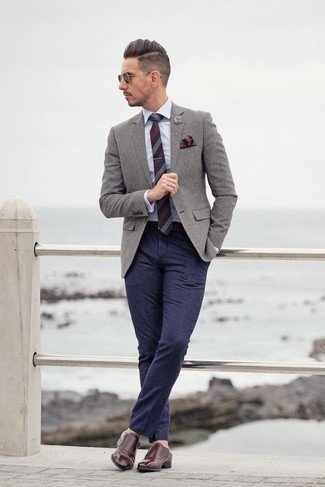 Lapel Pin Outfits: A grey wool blazer and a lapel pin are wonderful menswear essentials that will integrate really well within your current lineup. To give your overall outfit a sleeker twist, complement this look with burgundy leather double monks.