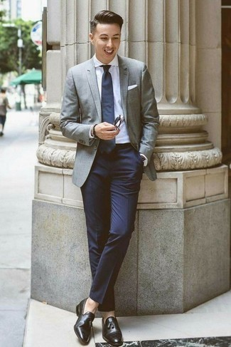 How to Wear Black Leather Tassel Loafers: For a look that's polished and absolutely envy-worthy, consider teaming a grey blazer with navy dress pants. Our favorite of a ton of ways to finish off this ensemble is with a pair of black leather tassel loafers.