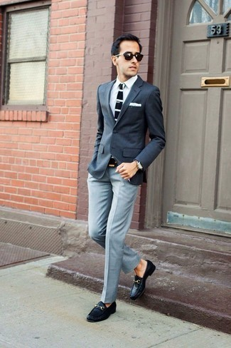 How to Wear Grey Dress Pants For Men: A charcoal blazer and grey dress pants are a seriously stylish combination for any gent to try. A pair of black woven leather loafers will never date.