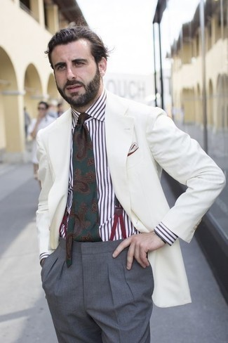 How to Wear a White and Brown Vertical Striped Dress Shirt For Men: Dial up your menswear game in a white and brown vertical striped dress shirt and grey dress pants.