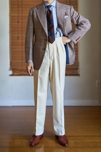 How to Wear a Brown Plaid Blazer For Men: We're loving the way this combo of a brown plaid blazer and beige dress pants immediately makes a man look sophisticated and dapper. Give an added dose of style to your ensemble by sporting a pair of brown leather oxford shoes.