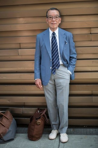 How to Wear a Light Blue Blazer For Men: For a look that's absolutely Kingsman-worthy, rock a light blue blazer with grey dress pants. Get a little creative in the footwear department and tone down this ensemble by slipping into white canvas low top sneakers.