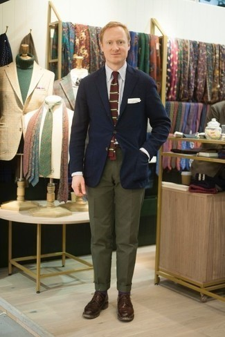 How to Wear a Navy Blazer For Men: To look nice and stylish, pair a navy blazer with olive dress pants. If not sure as to what to wear in the footwear department, go with a pair of dark brown leather derby shoes.