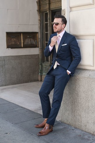 Nail that dapper look with a navy blazer jacket and navy blue suit pants. Brown leather chelsea boots will contrast beautifully against the rest of the look.