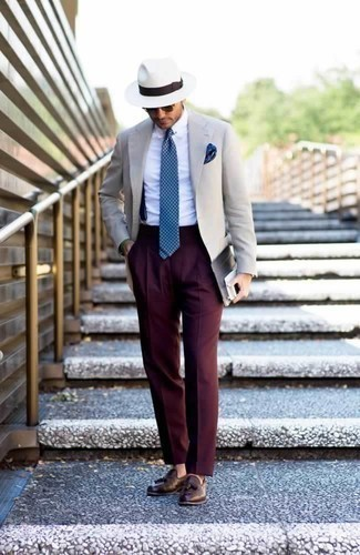 How to Wear Navy Suspenders: This look with a beige blazer and navy suspenders isn't hard to score and is open to more sartorial experimentation. Puzzled as to how to complete this outfit? Finish with brown leather tassel loafers to bump up the wow factor.