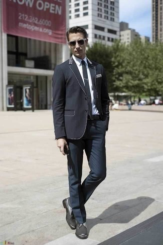 How to Wear a Black Blazer For Men: For a look that's elegant and Bond-worthy, pair a black blazer with navy dress pants. This look is rounded off really well with charcoal canvas derby shoes.