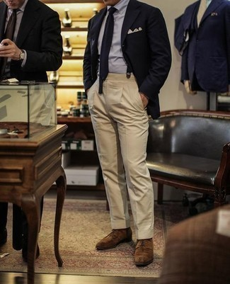 How to Wear Navy Suspenders: You'll be amazed at how easy it is for any gent to put together a modern casual outfit like this. Just a navy blazer teamed with navy suspenders. You know how to dress it up: brown suede derby shoes.