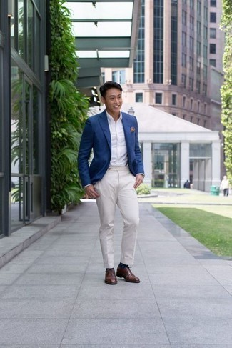 How to Wear Navy and White Polka Dot Socks For Men: For off-duty style without the need to sacrifice on comfort, we love this combo of a blue blazer and navy and white polka dot socks. Brown leather oxford shoes are guaranteed to give an added touch of style to your outfit.