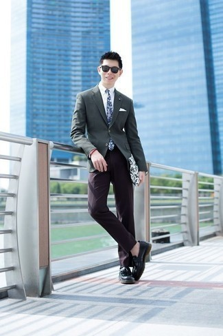 How to Wear a White Dress Shirt For Men: Pair a white dress shirt with dark purple dress pants and you're guaranteed to make an entrance. Throw a pair of black leather tassel loafers into the mix to easily kick up the fashion factor of this ensemble.